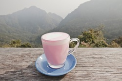 Rose Pink Latte with a beautiful view in the background. Chiang Rai, Thailand.