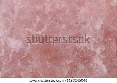 Rose quartz background. Closeup of pink rose quartz  surface.quartz gemstone pink macro #1193145046