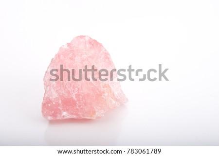 Rose Quartz crystal healing stone on white background #783061789