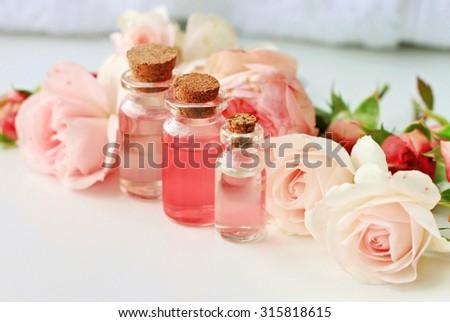 Rose spa setting aromatic water in bottles natural freshness soft delicate flowers feminine beauty