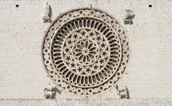 Rose window in Papal Basilica of Saint Francis of Assisi, (UNESCO World Heritage List), Umbria, Italy
