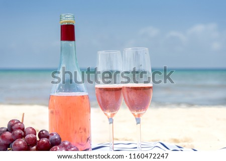 Rose wine in glasses at the beach
