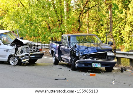 ROSEBURG, OR - AUGUST 29, 2013:Two vehicle head-on accident, caused by one truck failure to yield,  results in no injuries at a rural intersection in Roseburg, OR on August 29, 2013