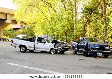 ROSEBURG, OR - AUGUST 29, 2013: Two vehicle head-on accident, caused by one truck failure to yield,  results in no injuries at a rural intersection in Roseburg, OR on August 29, 2013