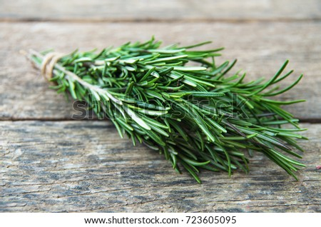 Rosemary bound on a wooden board #723605095