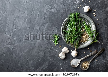 Rosemary, garlic, salt and white peppercorns, culinary background with various spices, directly above, flat lay, copy space #602973956