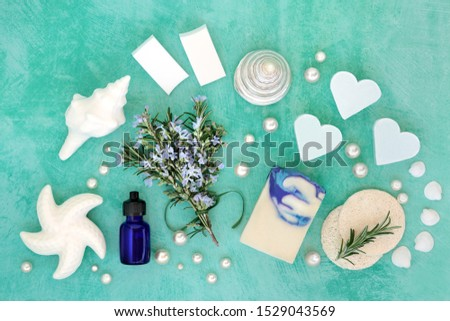 Rosemary herb skincare beauty treatment with aromatherapy essential oil, soaps & ex foliating scrubs. With astringent & anti ageing benefits and helps to reduce environmental skin damage. Flat lay