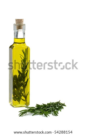 Rosemary infused olive oil over white background
