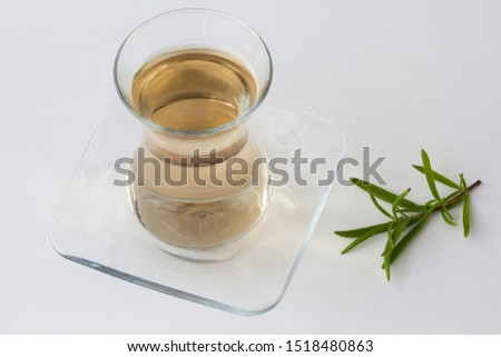 Rosemary tea in Armudu glass with branch of rosemary on the white table as background Photo stock ©
