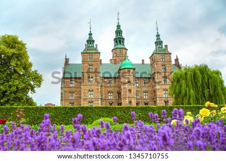 Rosenborg Castle in Copenhagen, Denmark. Lavender flowerbed in the small garden near the Rosenborg Palace. Rosenborg Slot castle in the Danish capital Copenhagen.