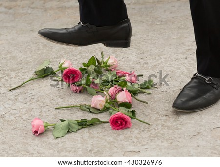 Roses being stomped on by a broken-hearted person