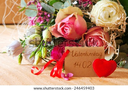 Roses bouquet and Valentine\'s Day card.