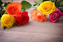 Roses. Bouquet of flowers. Bunch on wood background, with copy space.
