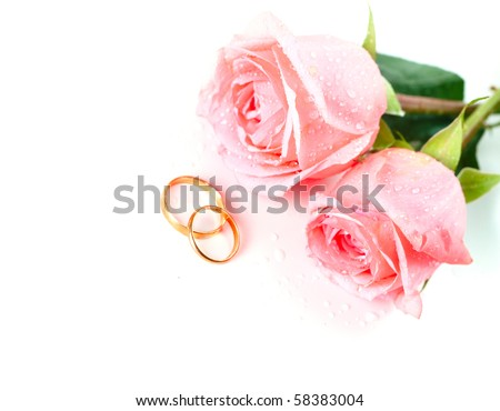 stock photo Roses flowers and two marriage wedding rings