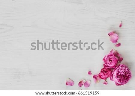 Roses frame on white wooden background #661519159