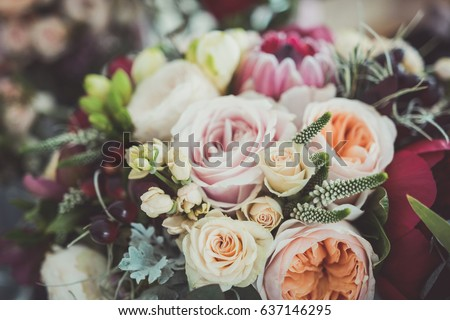 Roses in a brides flower bouquet - Shutterstock ID 637146295