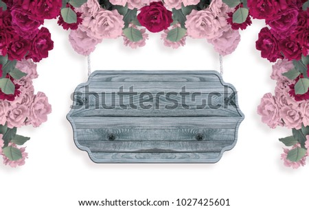 Roses isolated on white background with wooden signboard  and place for your photo or text. Floral garland. Copy space.