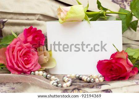 roses with pearls strand and blank card background