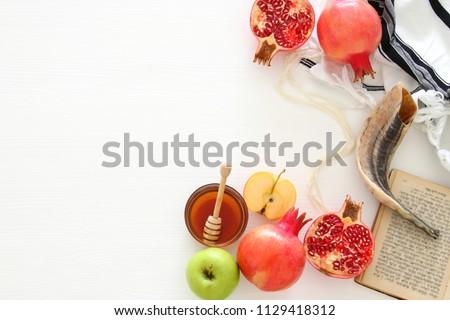 Rosh hashanah (jewish New Year holiday) concept. Traditional symbols - Shutterstock ID 1129418312