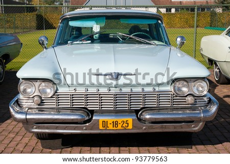ROSMALEN, THE NETHERLANDS - OCTOBER 15: A 1959 Chrysler New Yorker shown at the Rock Around the Jukebox event on October 15, 2011 in Autotron Rosmalen, Holland