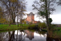 Ross Castle reflected at the river at Killarney, Co.Kerry, Ireland