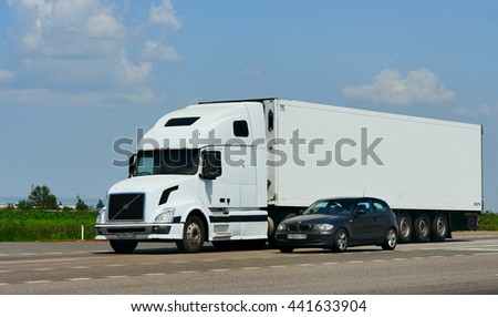 ROSTOV / DON. RUSSIA. M4-DON. June 23, 2016. The trailer transports cars on the highway M4 Don. June 16. Russia #441633904