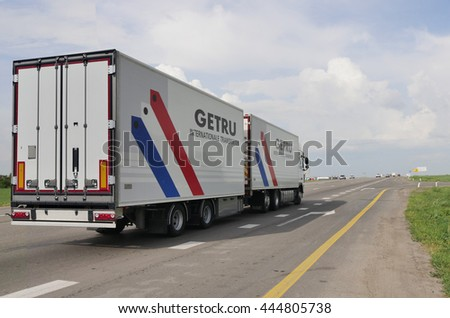 ROSTOV / DON. RUSSIA. M4-DON. June 23, 2016. The trailer transports cars on the highway M4 Don. June 16. Russia #444805738