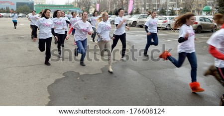 ROSTOV-ON-DON, RUSSIA - FEBRUARY 13: Flash-mob - 100m in uggah in support of the Olympic Games 2014. Rostov-on-Don, February 13, 2014 in Rostov-on-Don, Russia #176608124