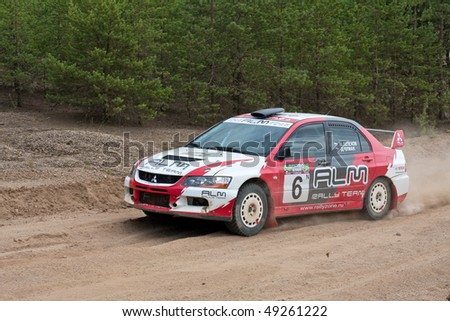 rostov russia july 27 alex potov drives a white and red mitsubishi lancer car during rostov. Black Bedroom Furniture Sets. Home Design Ideas