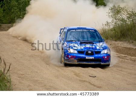 ROSTOV, RUSSIA - JULY 27: Alex Smirnov drives a Subaru Impreza  car during Rostov Velikiy Russian rally championship on July 27, 2008 in Rostov, Russia. - stock photo
