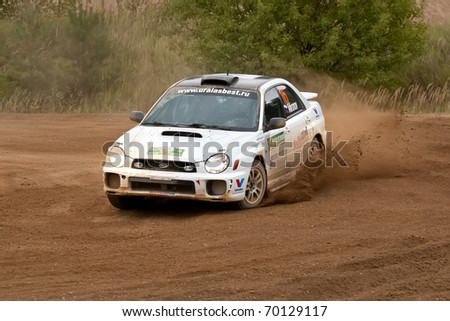 ROSTOV, RUSSIA - SEPTEMBER 05: Ilya Semenov drives a Subaru Impreza  car during Rostov Velikiy Russian rally championship on September 05, 2010 in Rostov, Russia.