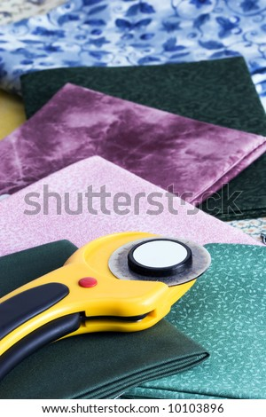 Rotary cutter on colorful fabrics.