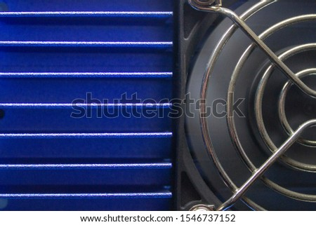rotating cooler with a shiny protective grill on a blue aluminum radiator