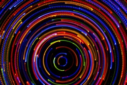 Rotating neon lights, spinning bright colorful laser lights background, modern nightlife and party concept, disco and dancing nightclubs pattern