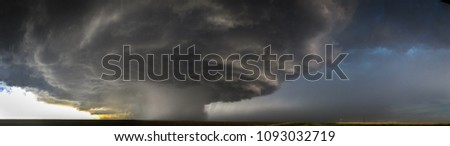 Rotating thunderstorm (supercell) with rain shaft.