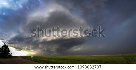 Rotating thunderstorm with wall cloud.