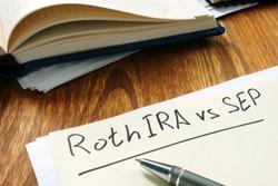 Roth IRA vs SEP handwritten on the yellow sheet.