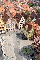 Rothenburg ob der Tauber in Bavaria, Germany. The Marktplatz square seen from the City Hall tower. Rothenburg is one of the best-preserved medieval towns in Europe, part of the Romantic Road.