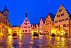 Rothenburg ob der Tauber. Main square (Marktplatz or Market square) of medieval German town of Rothenburg ob der Tauber evening panoramic view. Bavaria region of Germany