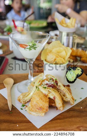 Roti fried cheese filling and chips on plate in restaurant