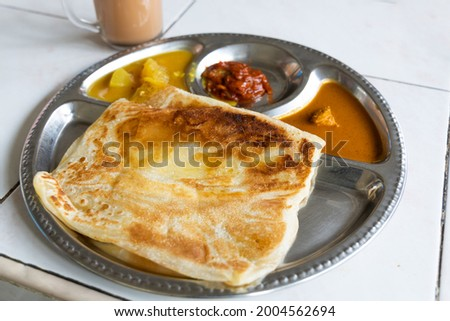 Roti planta is popular breakfast in Malaysia. It is roti canai with added margarine. Foto stock ©