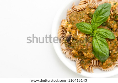 rotini pasta in a creamy basil pesto sauce with diced chicken breast