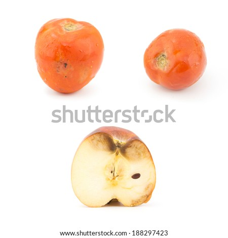 Rotten apple and tomato isolated on a white background