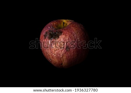 Rotten Apple isolated on black background. Concept of decay, aging, sadness and fading away.  Stock foto ©
