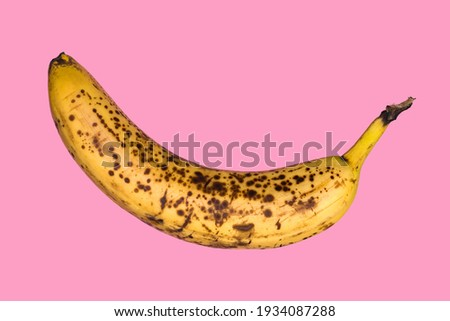 Rotten banana isolated on pink background. Expired fruit. Foto stock ©