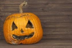 Rotten pumpkins on Halloween memory. End Halloween celebrations. Moldy old Halloween pumpkin.