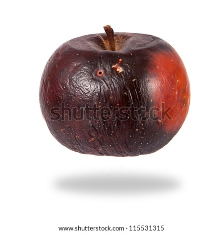Rotten red apple isolated over white background
