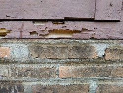 rotten wood on the brick wall