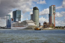 Rotterdam city center, arriving by boat, cruiseship at the quay