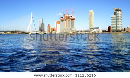 ROTTERDAM, HOLLAND - AUGUST 02: Panoramic view over Erasmus Bridge and Rotterdam port. Erasmus Bridge is one of the icons of Rotterdam on August 02, 2012 in Rotterdam, Holland.